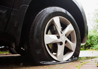 Can I Leave My Car Parked With A Flat Tire?